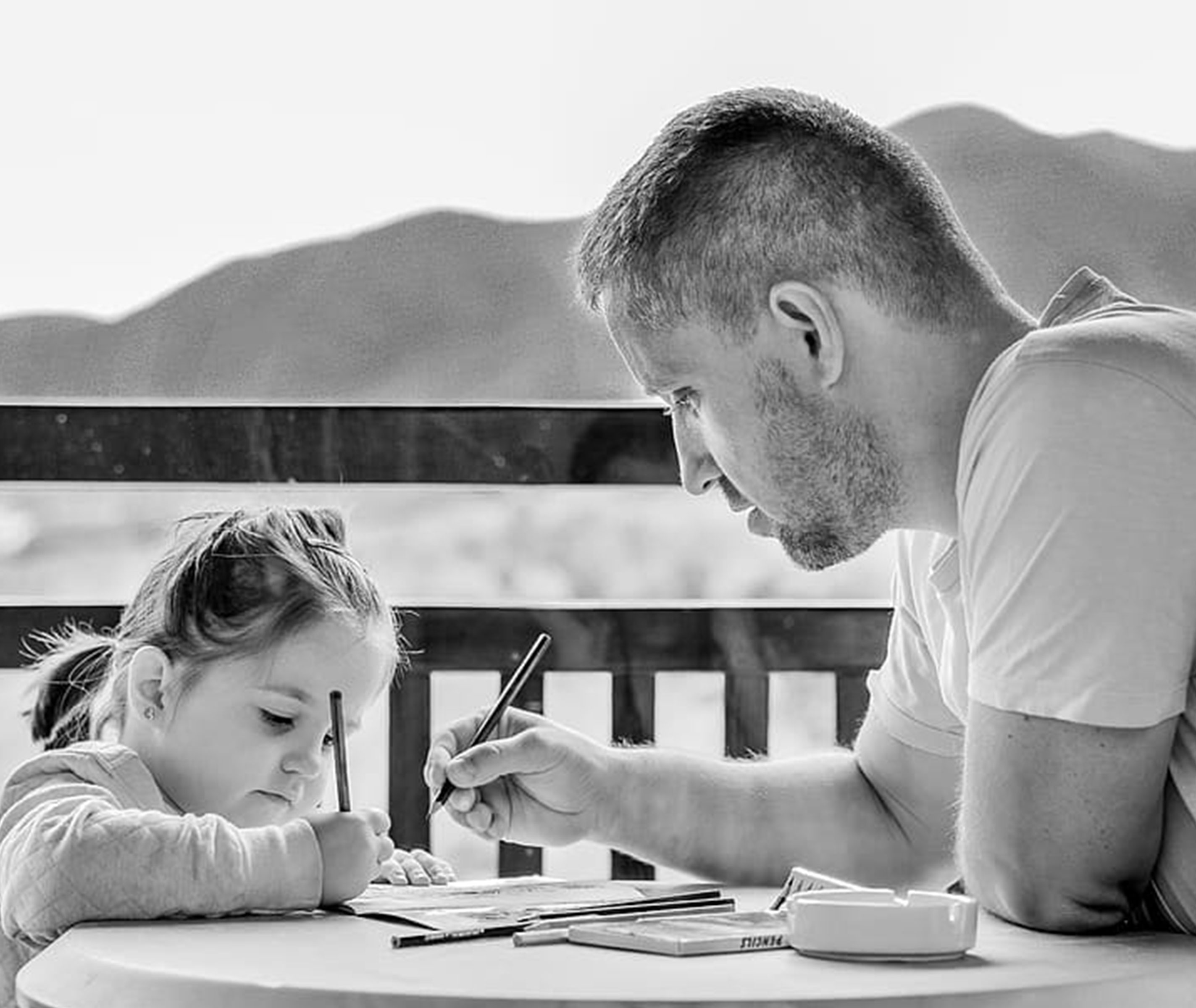Dad teaching bible lessons to his daughter